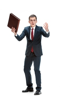 Portrait of businessman with folder on white wall