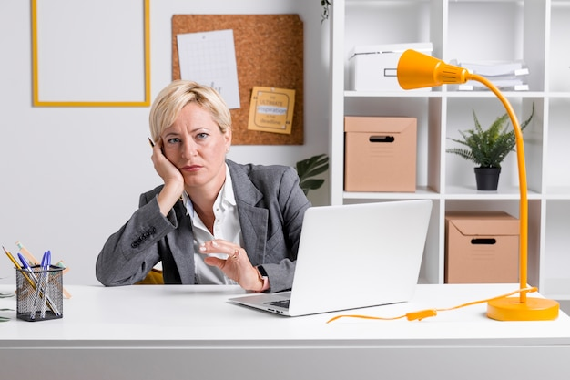Portrait of businesswoman at desk