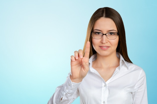 Portrait of businesswoman pointing at floating screen