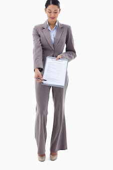 Portrait of a businesswoman showing a contract