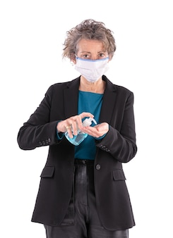 Portrait of a businesswoman with a mask and hydroalcoholic gel on a white background