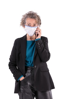 Portrait of a businesswoman with a mask on a white background