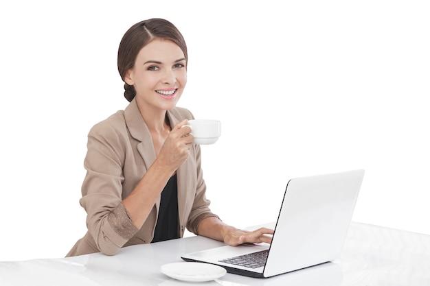 Portrait businesswoman working on laptop