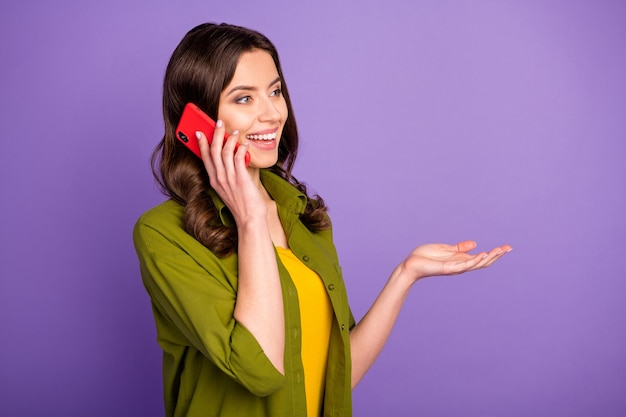 Portrait of candid content pretty girl use smartphone call her friends have interesting talk wear good look clothes isolated over violet vivid color background