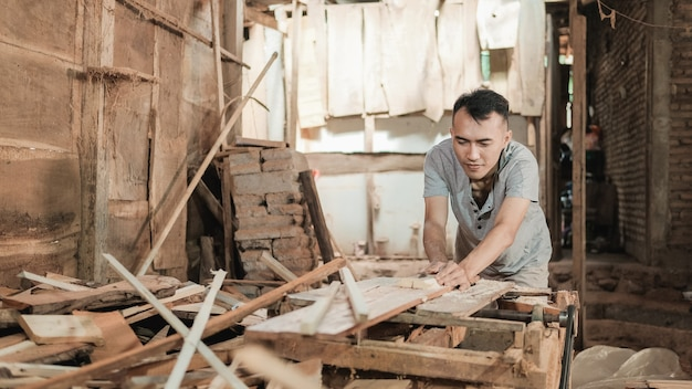 Portrait of a carpenter in his workspace