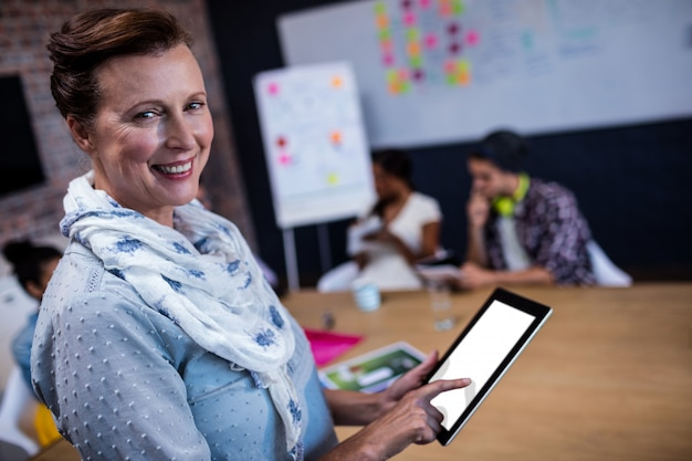 Portrait of a casual businesswoman using a tablet computer