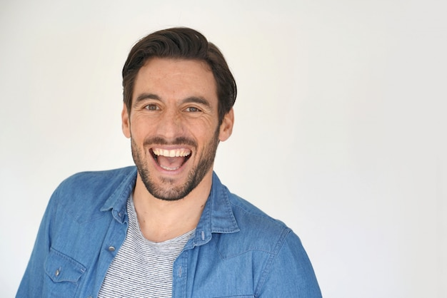 Portrait of casual laughing handsome man