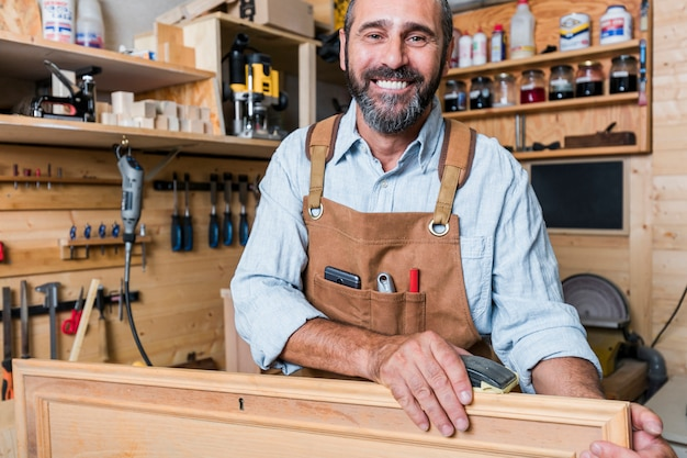 Portrait of caucasian carpenter at work