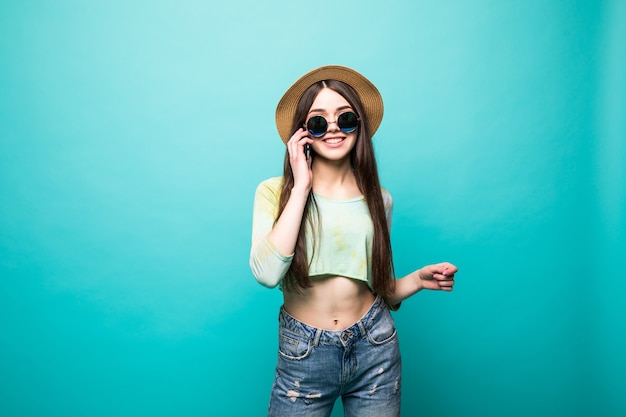 Portrait of charming, cool, pretty, sexy girl in black glasses, holding smart phone near ear, speaking with friends, having call from her lover, isolated