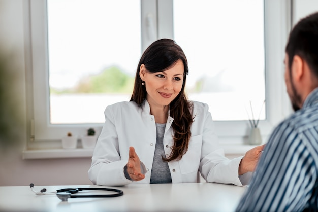 Portrait of a charming doctor talking with a patient.