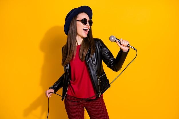 Portrait of charming girl singing karaoke performing having fun