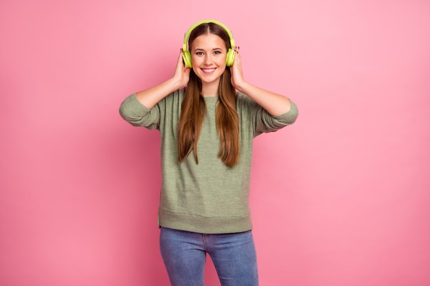 Portrait of charming lovely pretty girl listen music in headset