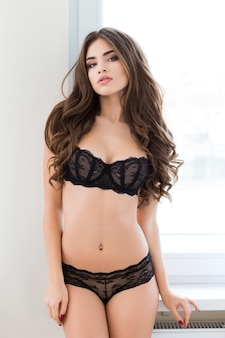 Portrait of a charming sexy woman in lingerie looking at camera
