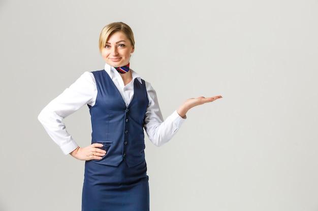 Portrait of charming stewardess wearing in blue uniform