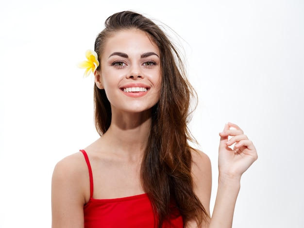 Portrait of charming woman in red tshirt with yellow