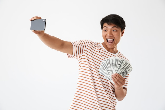 Portrait of a cheerful asian man taking a selfie