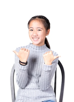 Portrait of cheerful asian teenager toothy smiling face on white background