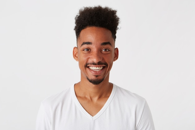 Portrait of cheerful attractive african american young man