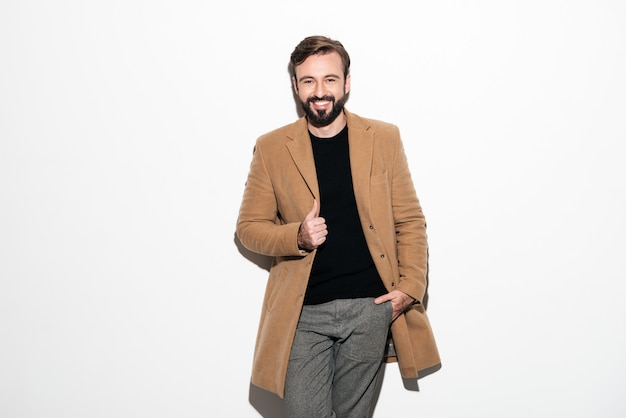 Portrait of a cheerful bearded man dressed in a coat