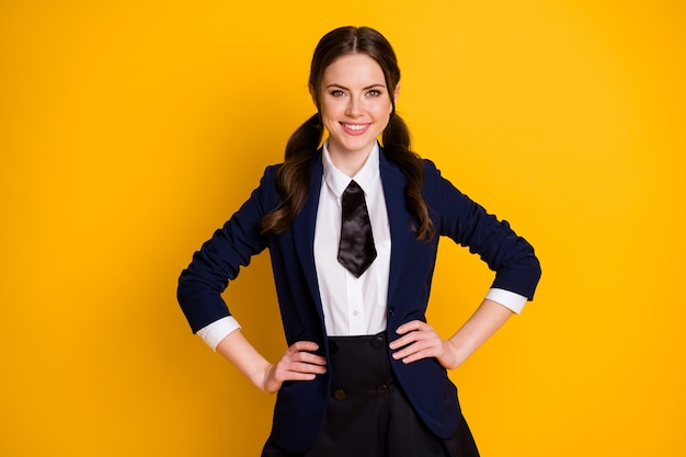 Portrait cheerful charming college student girl waist hands