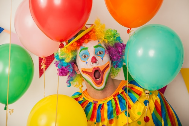 Portrait of a cheerful clown at a party