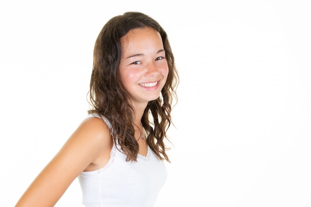 Portrait of cheerful curly brunette teenager girl laughing