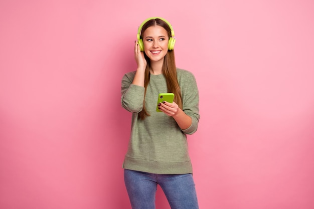 Portrait of cheerful excited girl use smartphone listen music