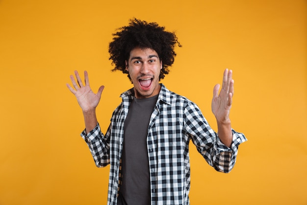 Portrait of a cheerful excited young afro american man