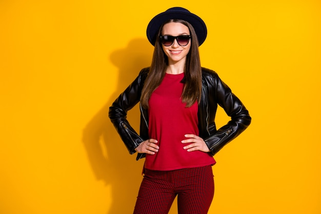 Portrait of cheerful girl stylish outfit hands hips posing