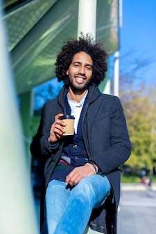 Portrait of cheerful handsome afro man in casual wear posing