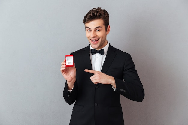 Portrait of a cheerful happy man dressed in tuxedo