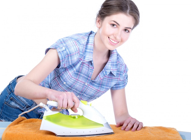 Portrait of cheerful housewife ironing clothes.