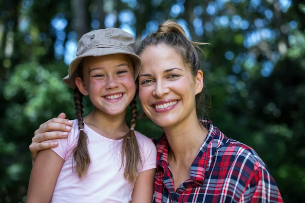 Portrait of cheerful mother with daughter