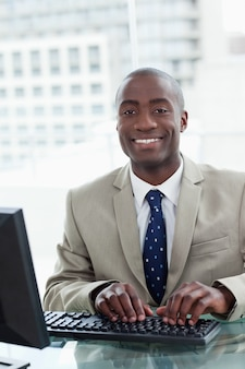 Portrait of a cheerful office worker using a computer
