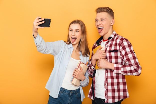 Portrait of a cheerful teenage school couple