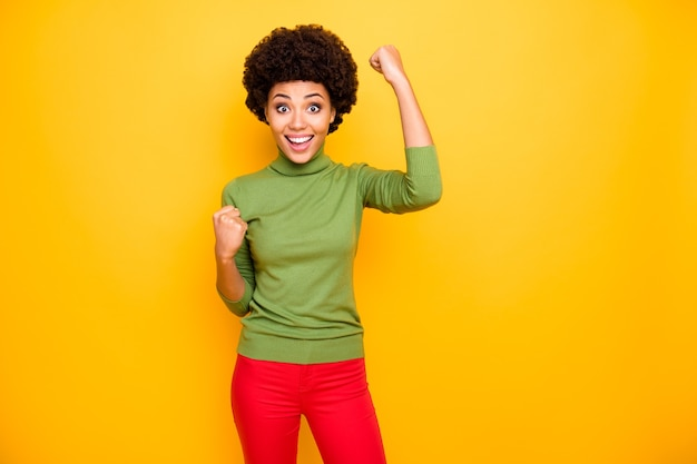 Portrait of cheerful trendy charming cute girl rejoicing in winning lottery in red trousers sales discount.