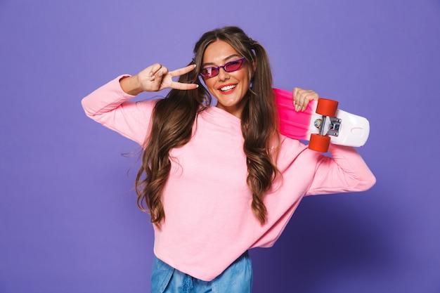Portrait of a cheerful woman in sweatshirt posing
