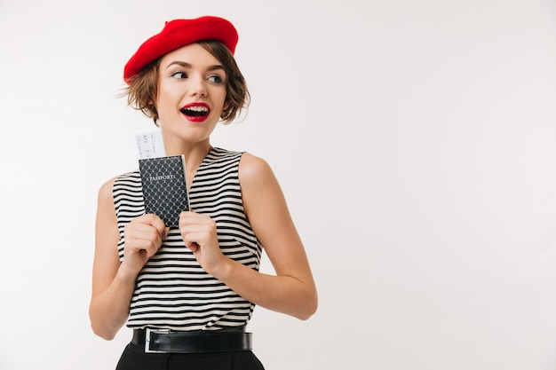 Portrait of a cheerful woman wearing red beret