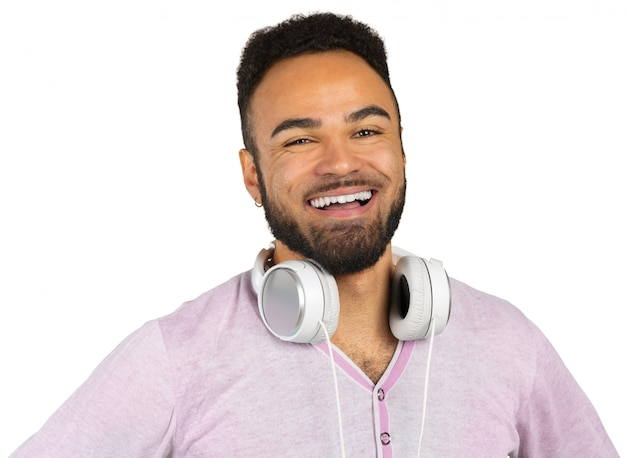 Portrait of a cheerful young afro american man listening to music with headphones