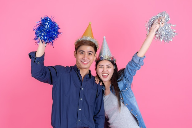 Portrait cheerful young couple with party prop