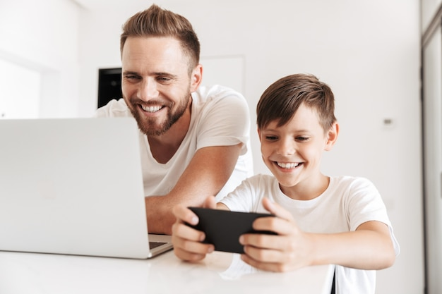 Portrait of a cheerful young father and his son