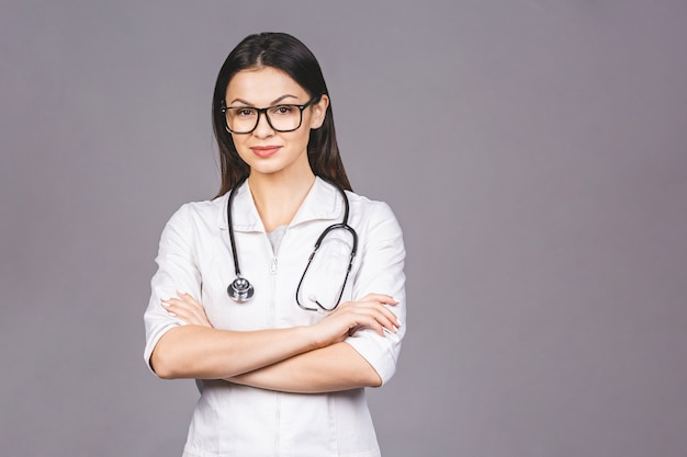 Portrait of cheerful young female doctor with stethoscope over neck