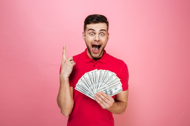 Portrait of a cheerful young man holding money