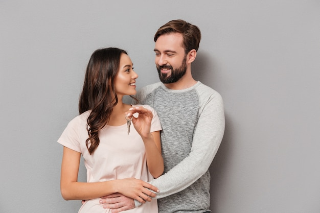 Portrait of a cheery young couple hugging