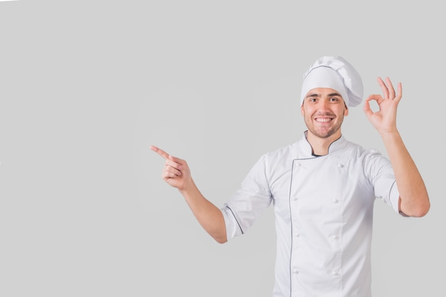 Portrait of chef doing tasty gesture