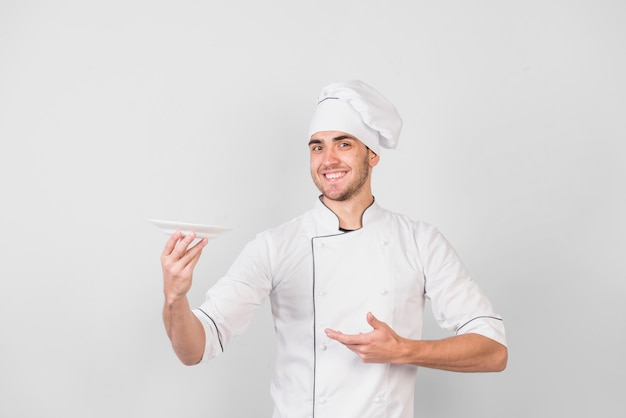 Portrait of chef with plate