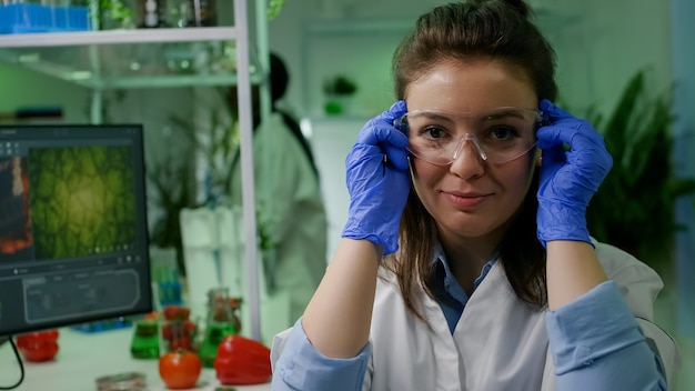 Portrait of chemist researcher in medical equipment looking into camera