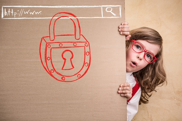 Portrait of child businessman in office. internet security concept