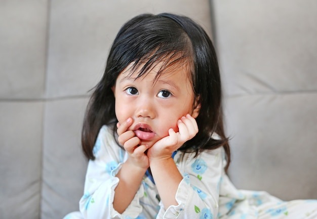 Portrait of child girl with snot flowing from her nose