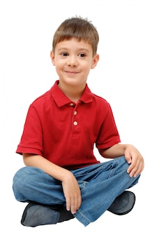 Portrait of child sitting on floor isolated on white